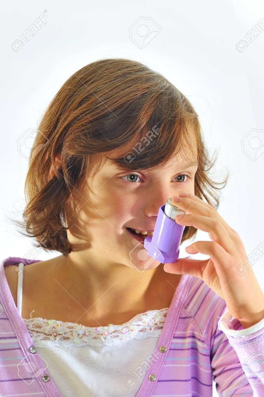 girl using inhaler Stock Photo - 8784165