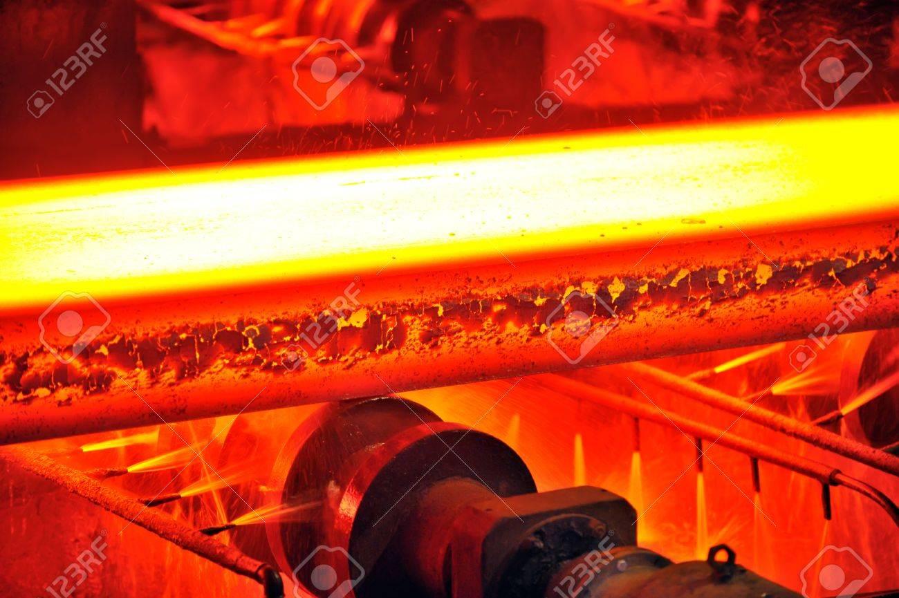 hot steel on conveyor Stock Photo - 11931624