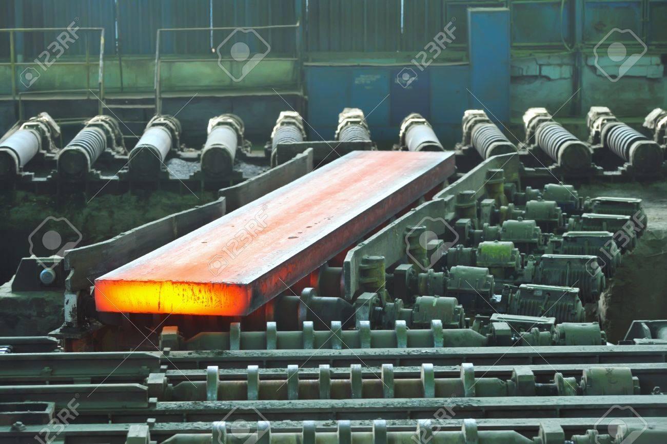 hot steel on conveyor Stock Photo - 11931620