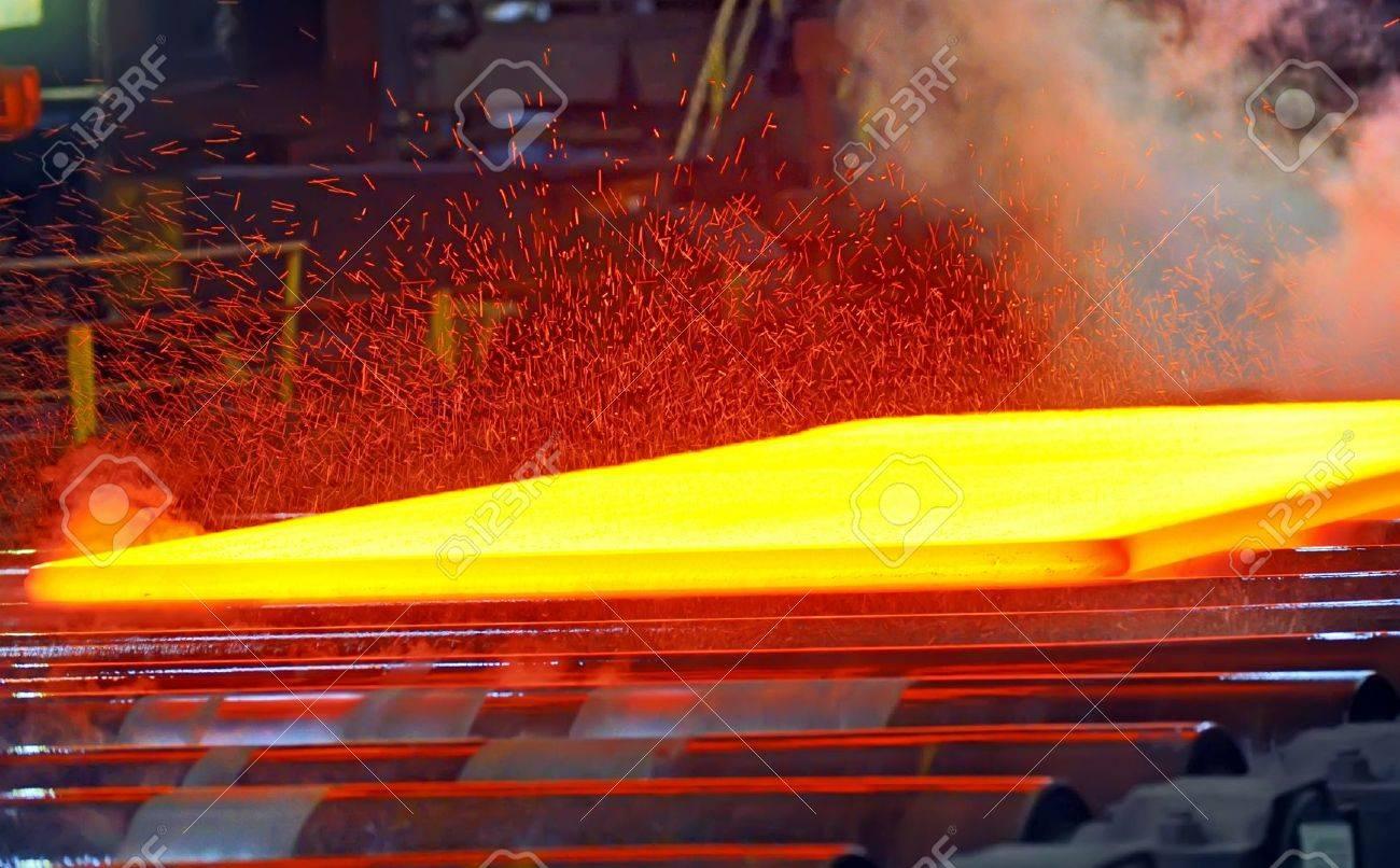 hot steel on conveyor Stock Photo - 16477379
