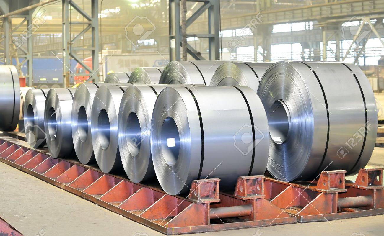 rolls of steel sheet in a warehouse - 16477696