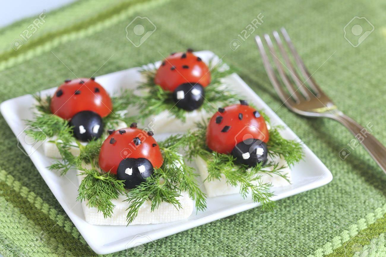 ladybug tomato and olive with cheese Stock Photo - 16480343