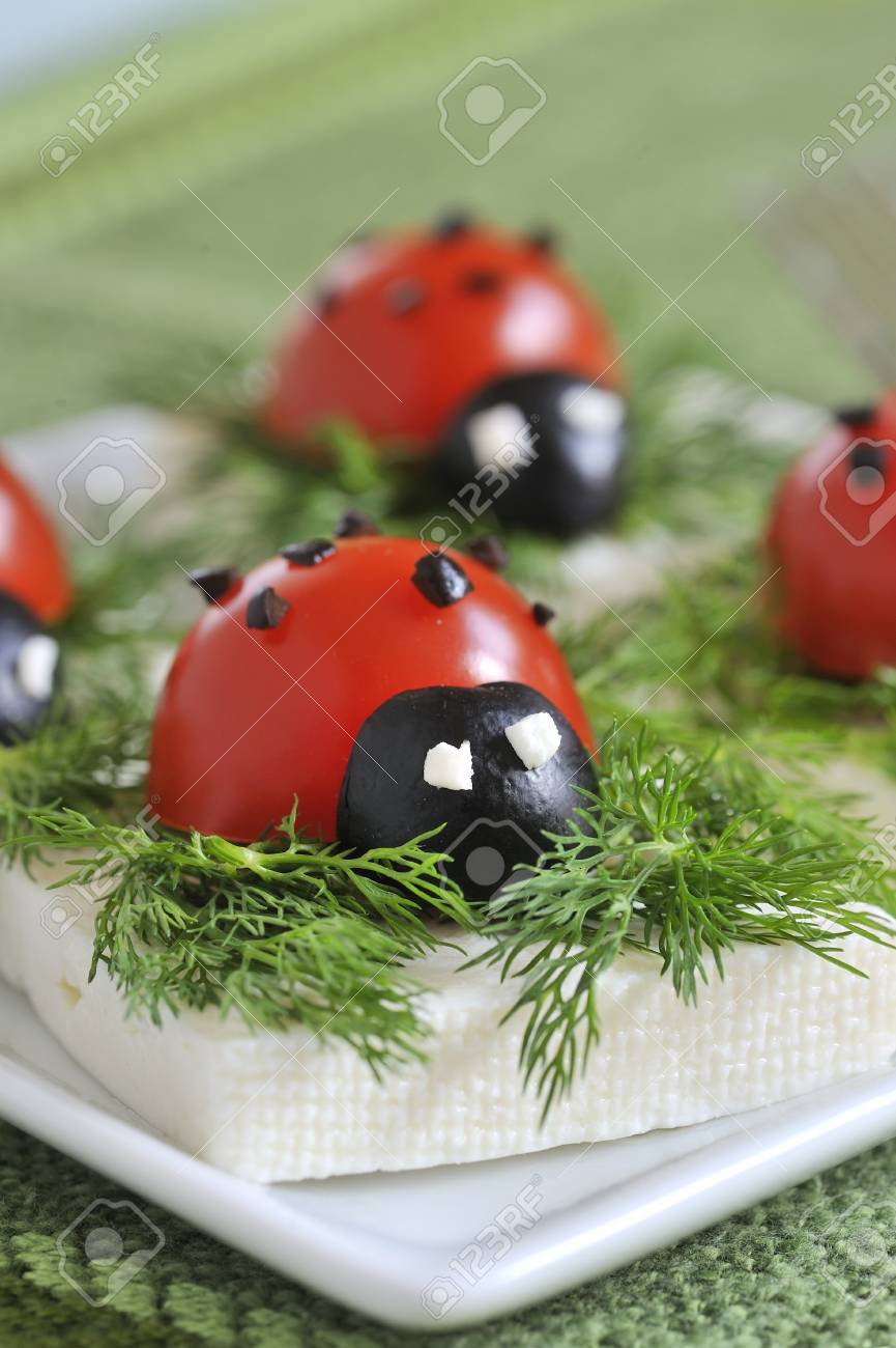 ladybug tomato and olive with cheese Stock Photo - 16480292