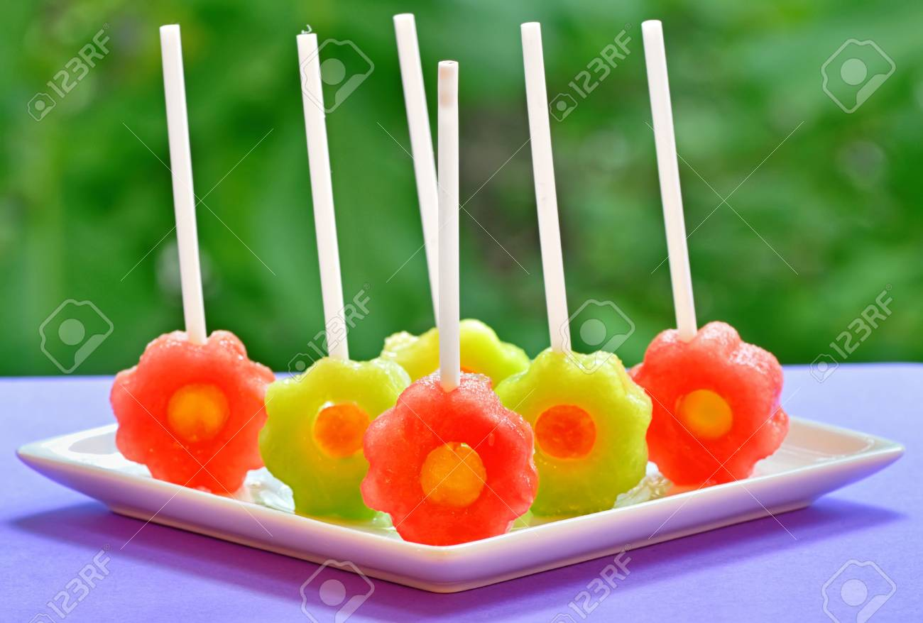 fruit pops of melon and watermelon on natural background Stock Photo - 20332357