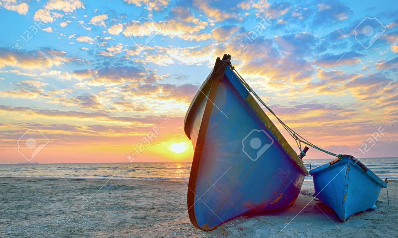 blue fisherman boats and sunrise Stock Photo - 22116448