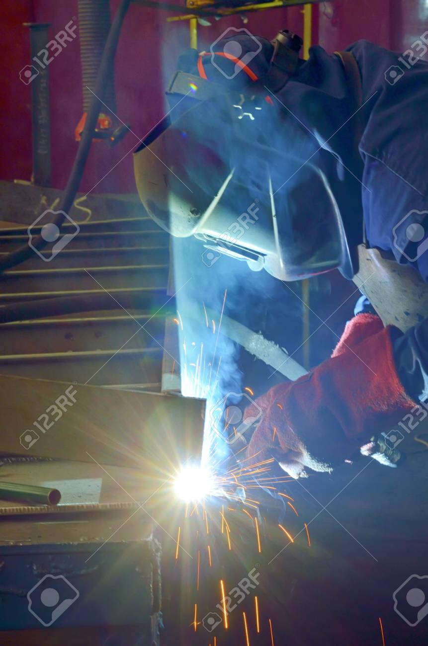 welder with protective mask welding metal and sparks Stock Photo - 22142503