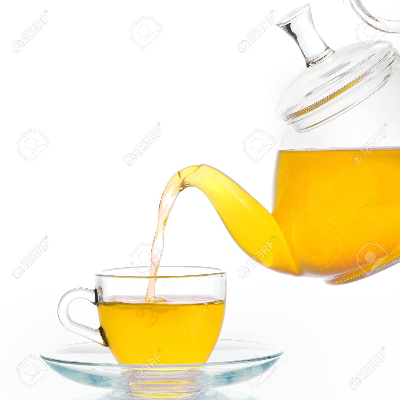 Glass teapot and  cup of tea  isolated Stock Photo - 23216321