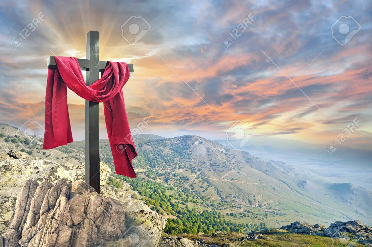 cross with red cloth against the dramatic sky - 94999285