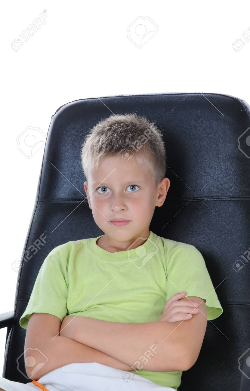 Confident boy sit on chair and look at camera. on white background Stock Photo - 5676033