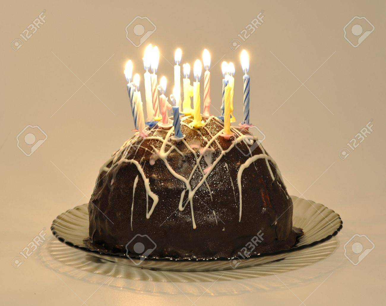 Wondrous Chocolate Cake With Candles On A Cake Plate On A White Background Birthday Cards Printable Trancafe Filternl