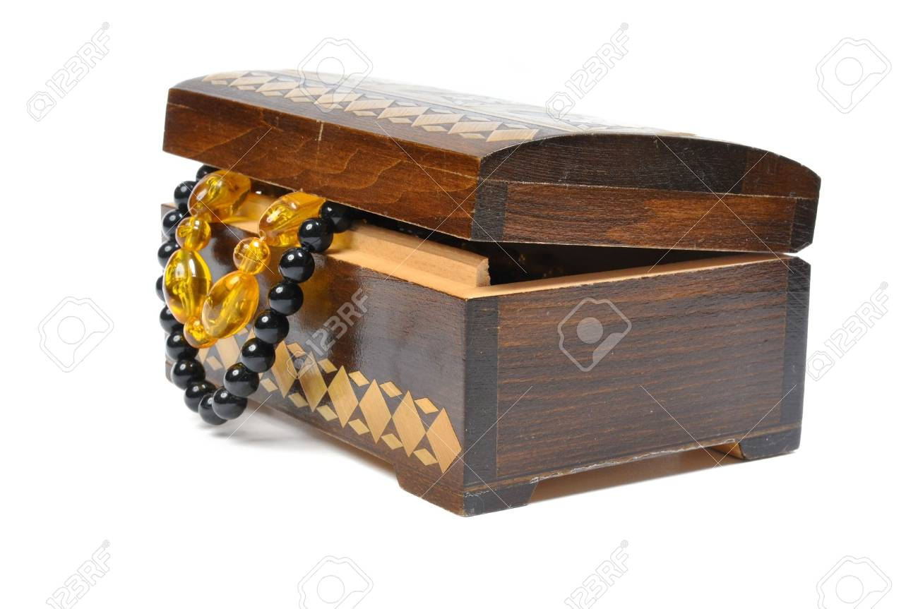 wooden box with jewelry on a white background Stock Photo - 6045079