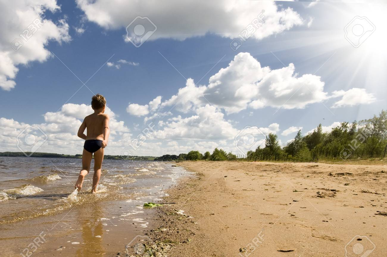 young boy running at the beautiful beach of river Stock Photo - 7310650