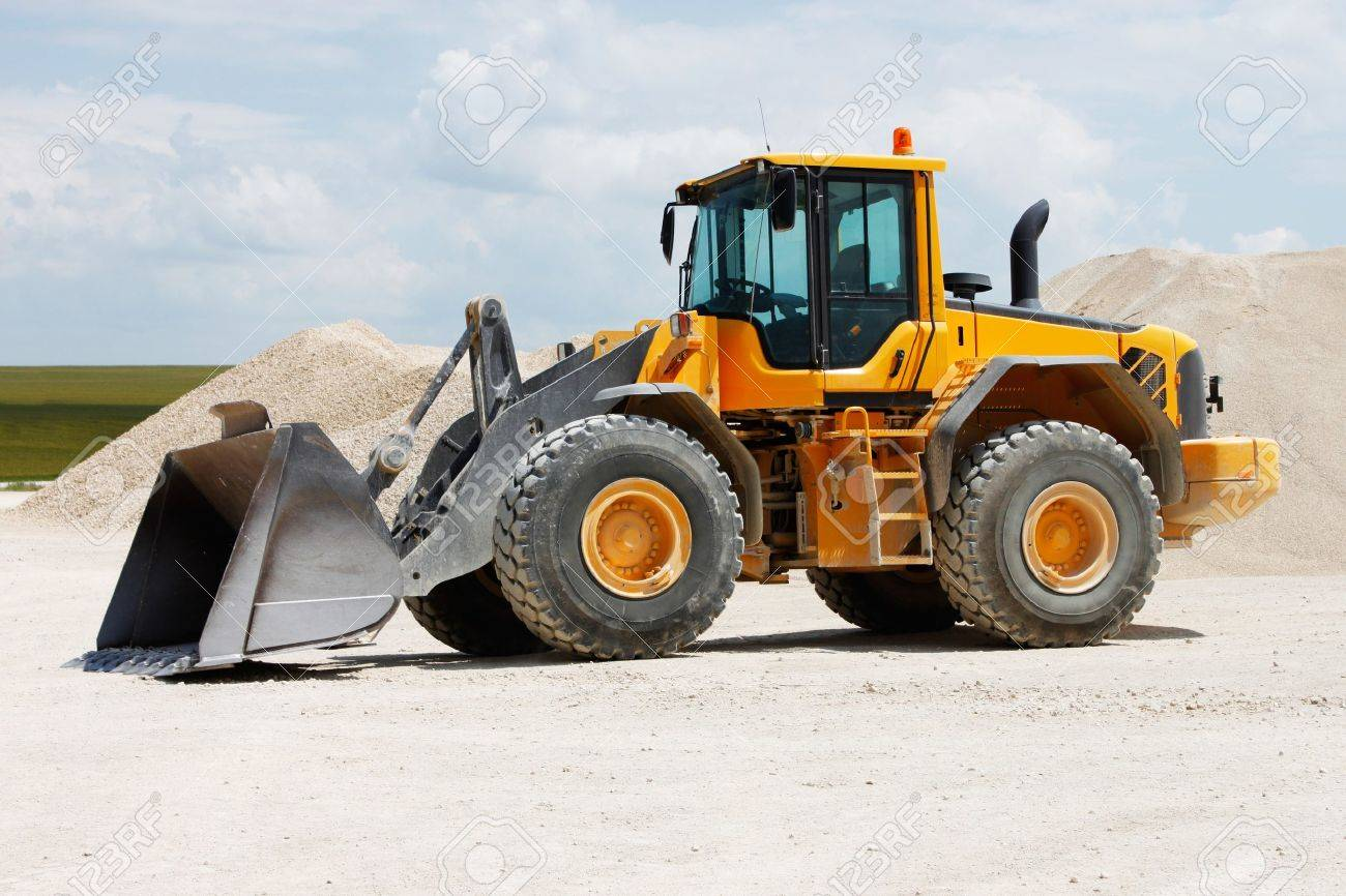 Yellow Excavator at Construction Site Stock Photo - 7424630
