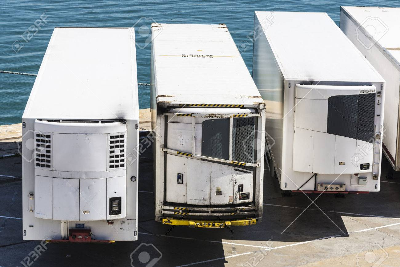 Reefer containers waiting to board at the port of Barcelona, Catalonia, Spain - 39570060