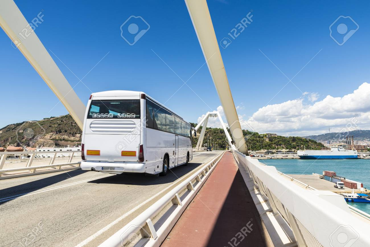 White bus circulating on a drawbridge over the port of Barcelona, Catalonia, Spain - 40391446