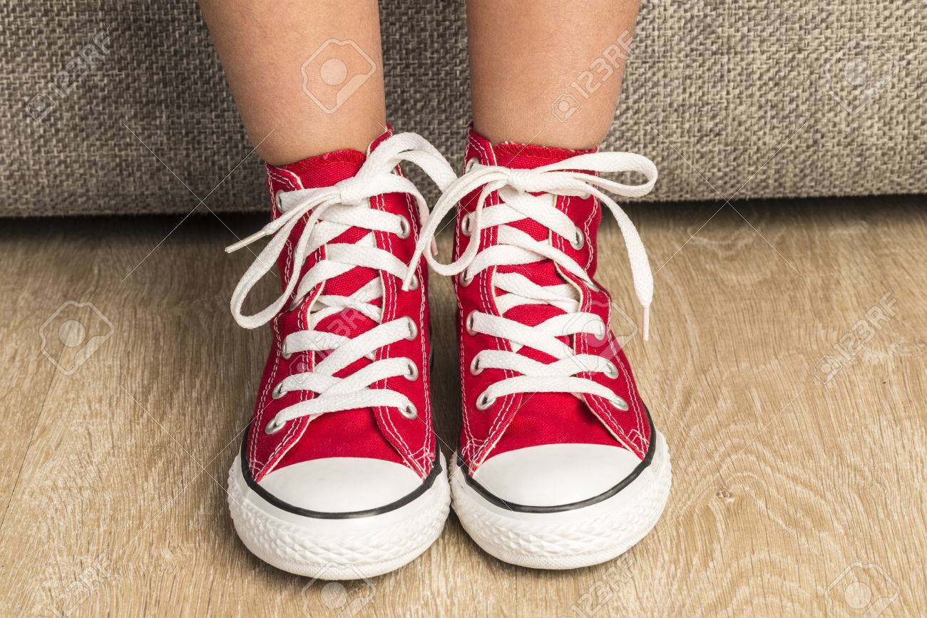 Little Girl Wearing A Pair Of Red