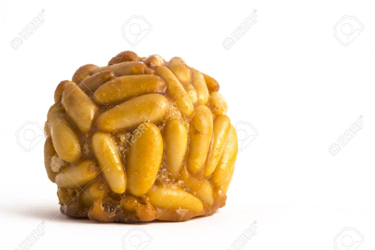 Panellet pine nuts isolated on white. Panellet are traditional desserts of All Saints holiday, known as Castanyada in Catalonia, Spain - 47275963