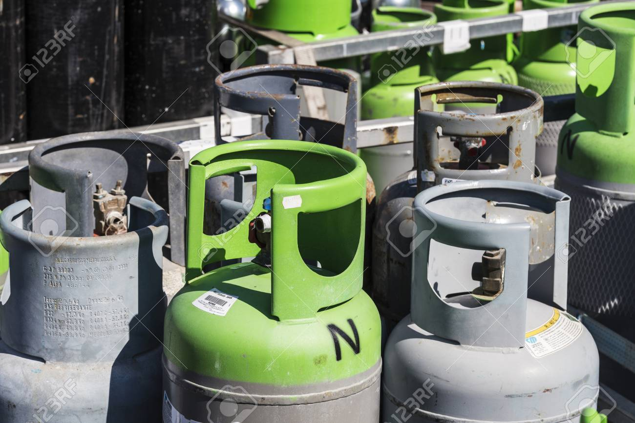 Barcelona, Spain - April 19, 2016: Refrigerant gas cylinders ready for transport in the port of Barcelona, Catalonia, Spain - 55991700