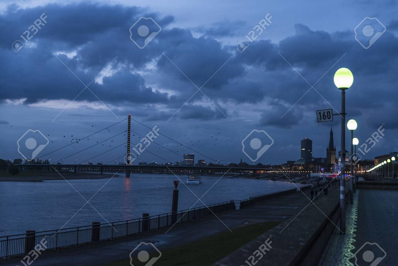 View of the promenade and the Oberkassel bridge at night in Dusseldorf, Germany - 85882600