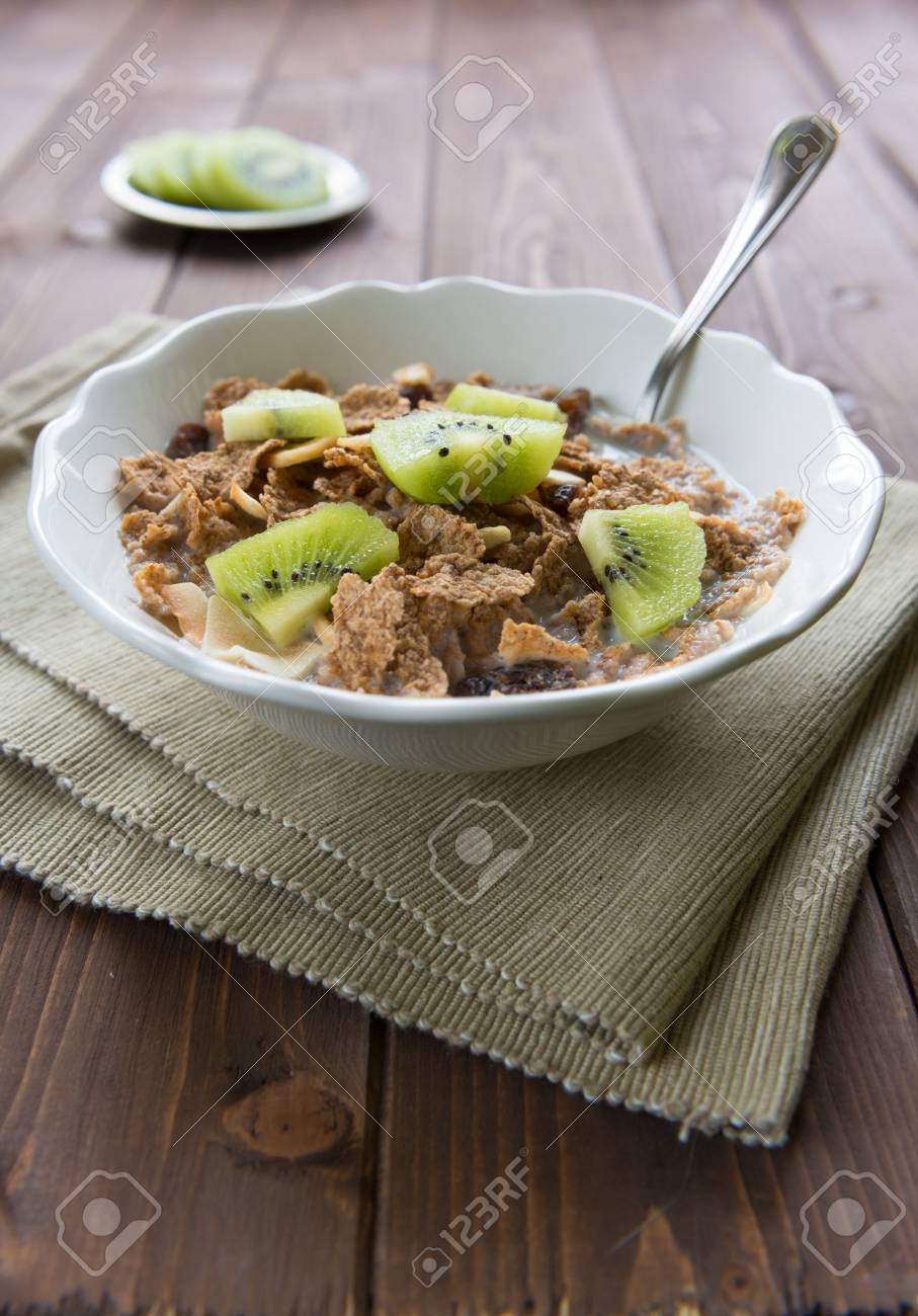 Bowl with corn flakes and kiwi for nourishing breakfast Stock Photo - 18220854