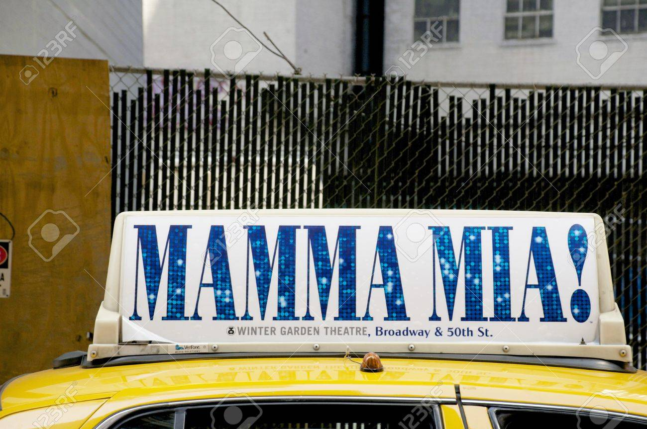 yellow taxi cab in new york with a mamma mia sign stock photo