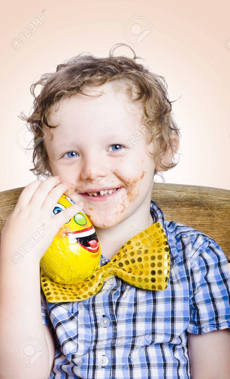 Smiling Happy Kid With Messy Chocolate Face Holding Gift Egg ...