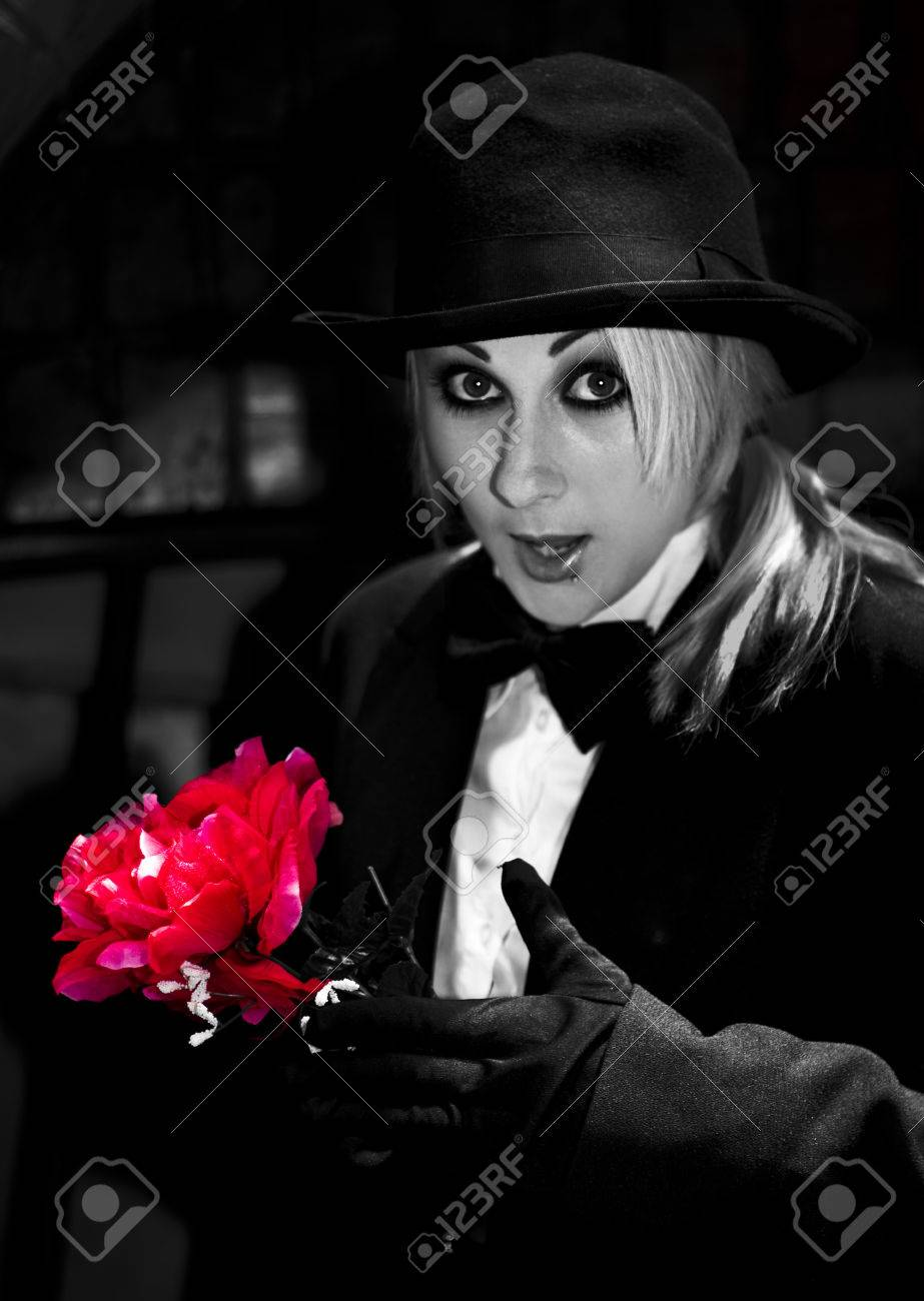 A Magician Pulls A Red Flower Out Of Her Sleeve In A Romantic ...