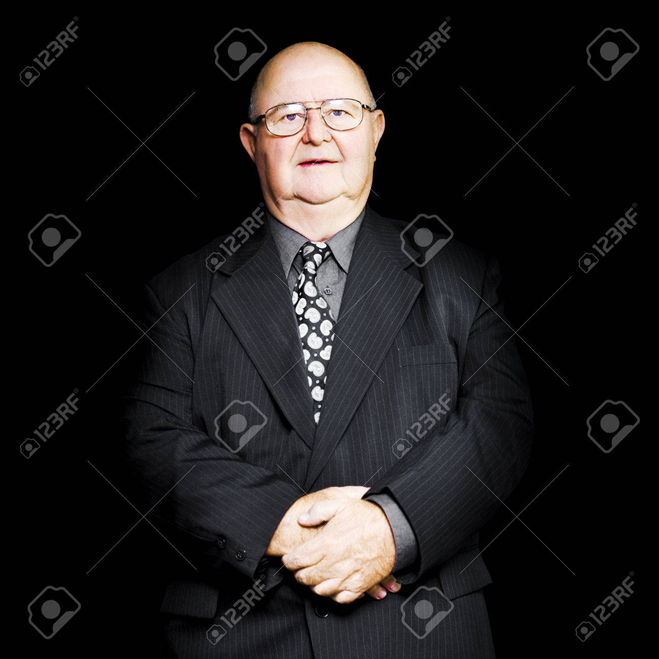 retirement advisor stock photos pictures royalty retirement advisor isolated studio portrait of a senior business man wearing glasses and suit