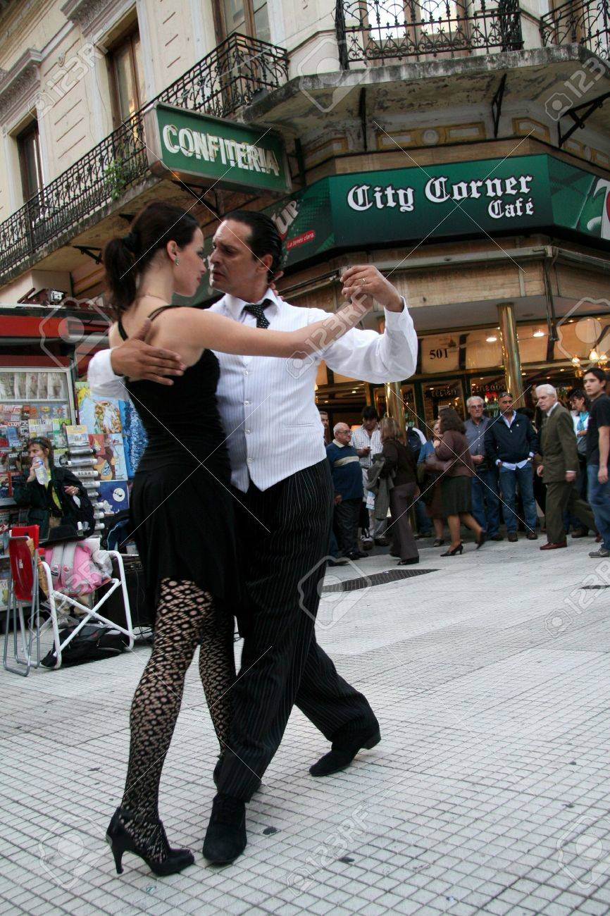 Buenos Aires, Argentina - May 14, 2008: Couple dancing Tango on the Florida street in Buenos Aires - 6884439