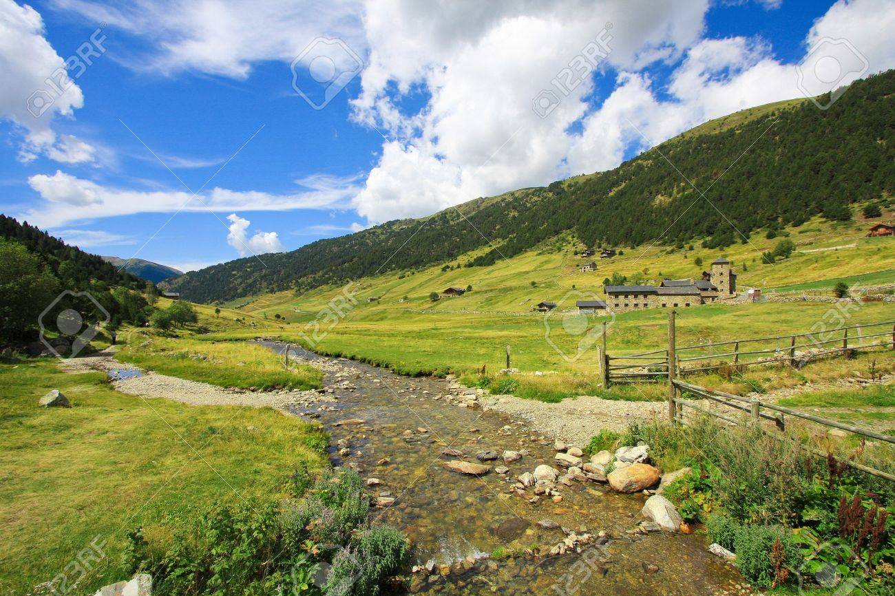 Mountain river through Vall d'Incles landscape in Andorra, at the Pyrenees mountains - 8607503