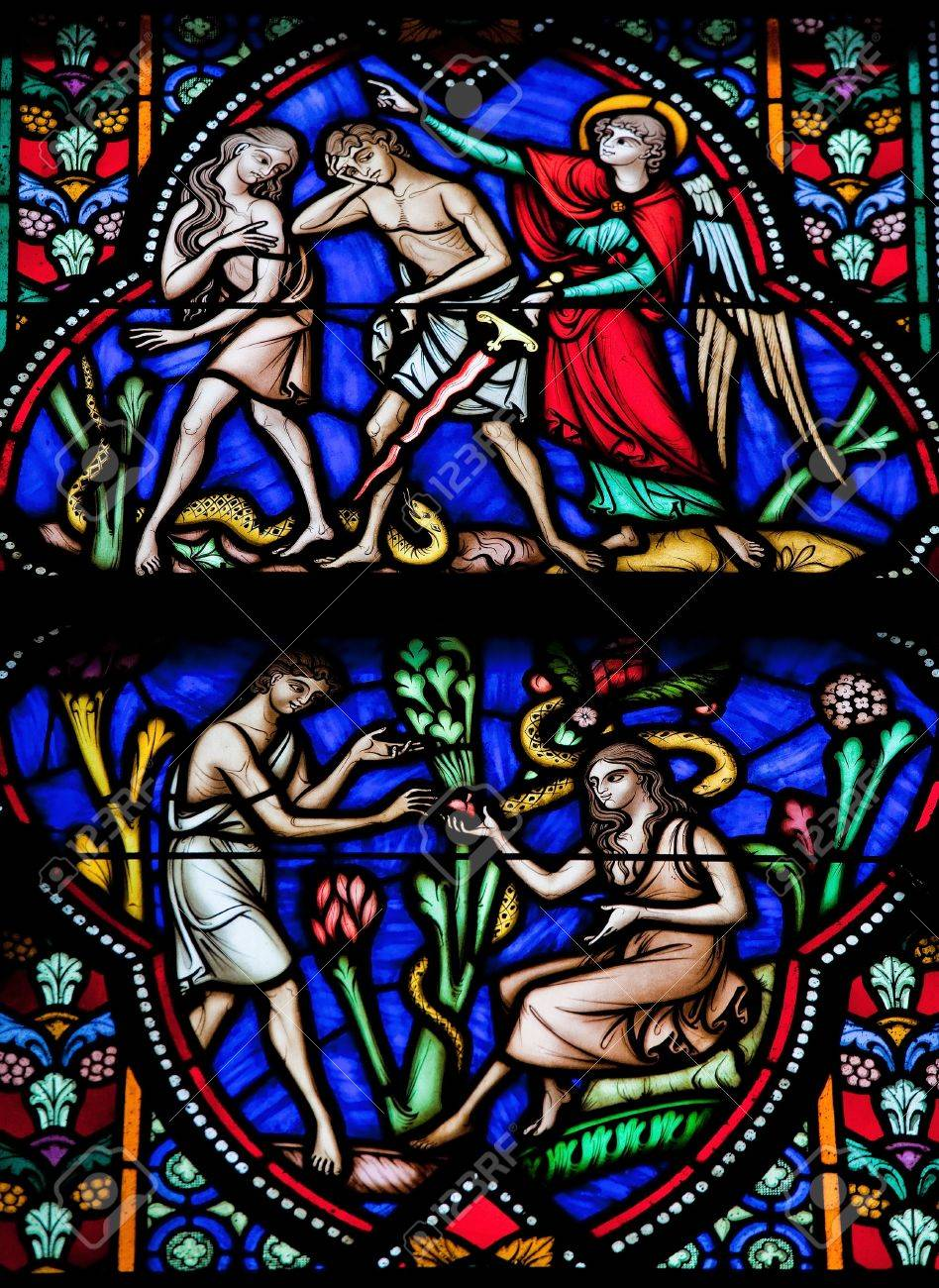 Adam and Eve eat the Forbidden Fruit and are expelled from Paradise  This window was created more than 150 years ago, no property release is required  Stock Photo - 14621969