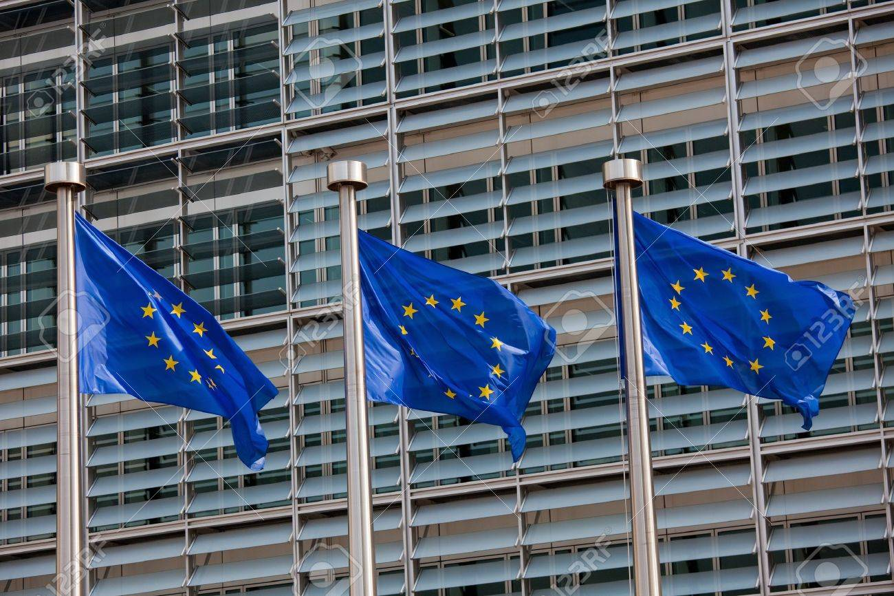 European flags in front of the Berlaymont building, headquarters of the European commission in Brussels. Stock Photo - 15568516