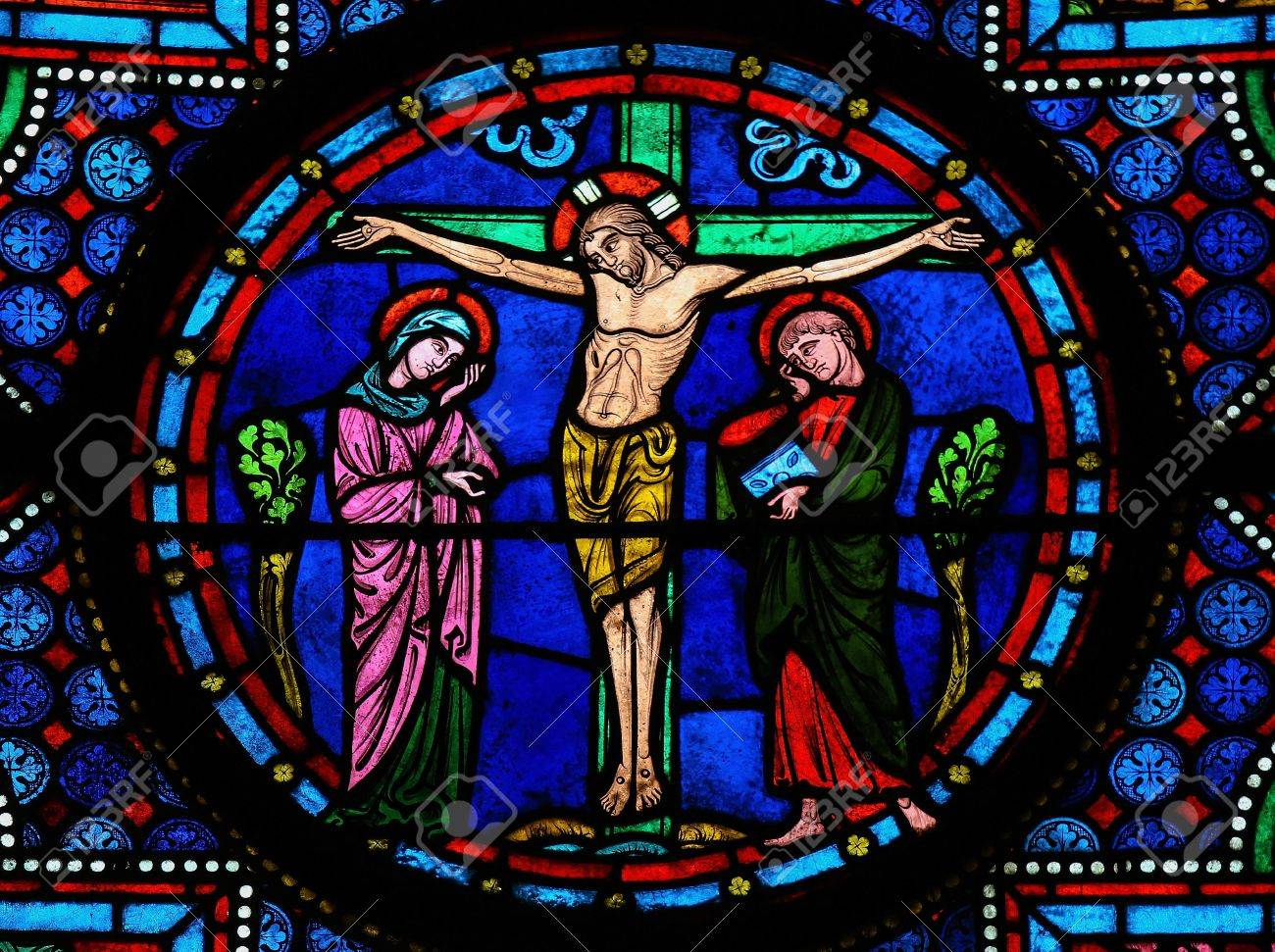 Stained glass window depicting Jesus on the Cross in the cathedral of Bayeux, Normandy, France. This window was created in the 15th century, no property release is required. - 17950849