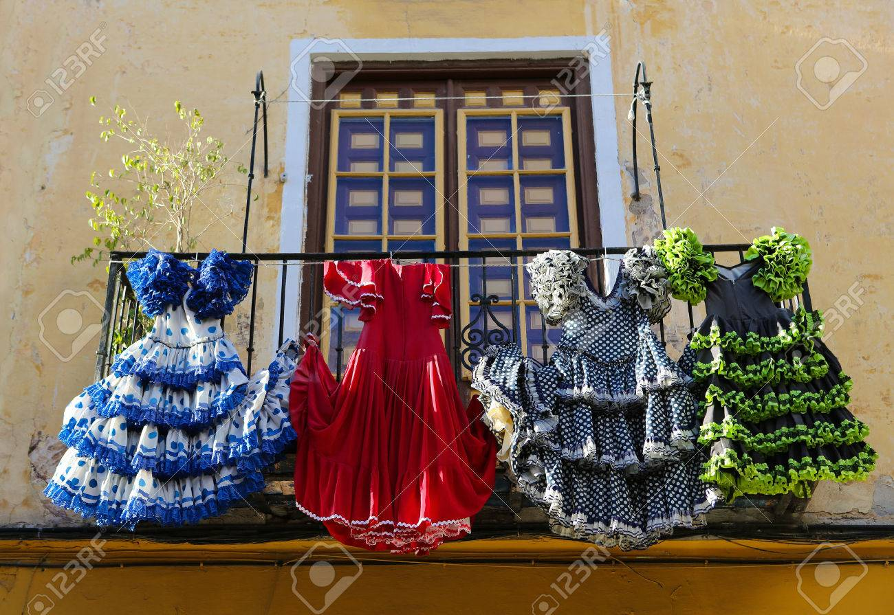 Traditional flamenco dresses at a house in Malaga, Andalusia, Spain. - 35780621