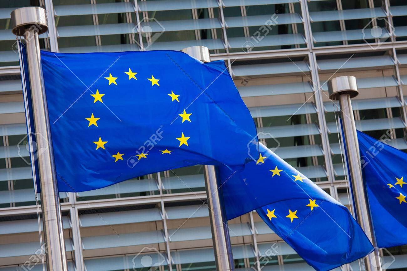 European flags in front of the Berlaymont building, headquarters of the European commission in Brussels. - 37205610