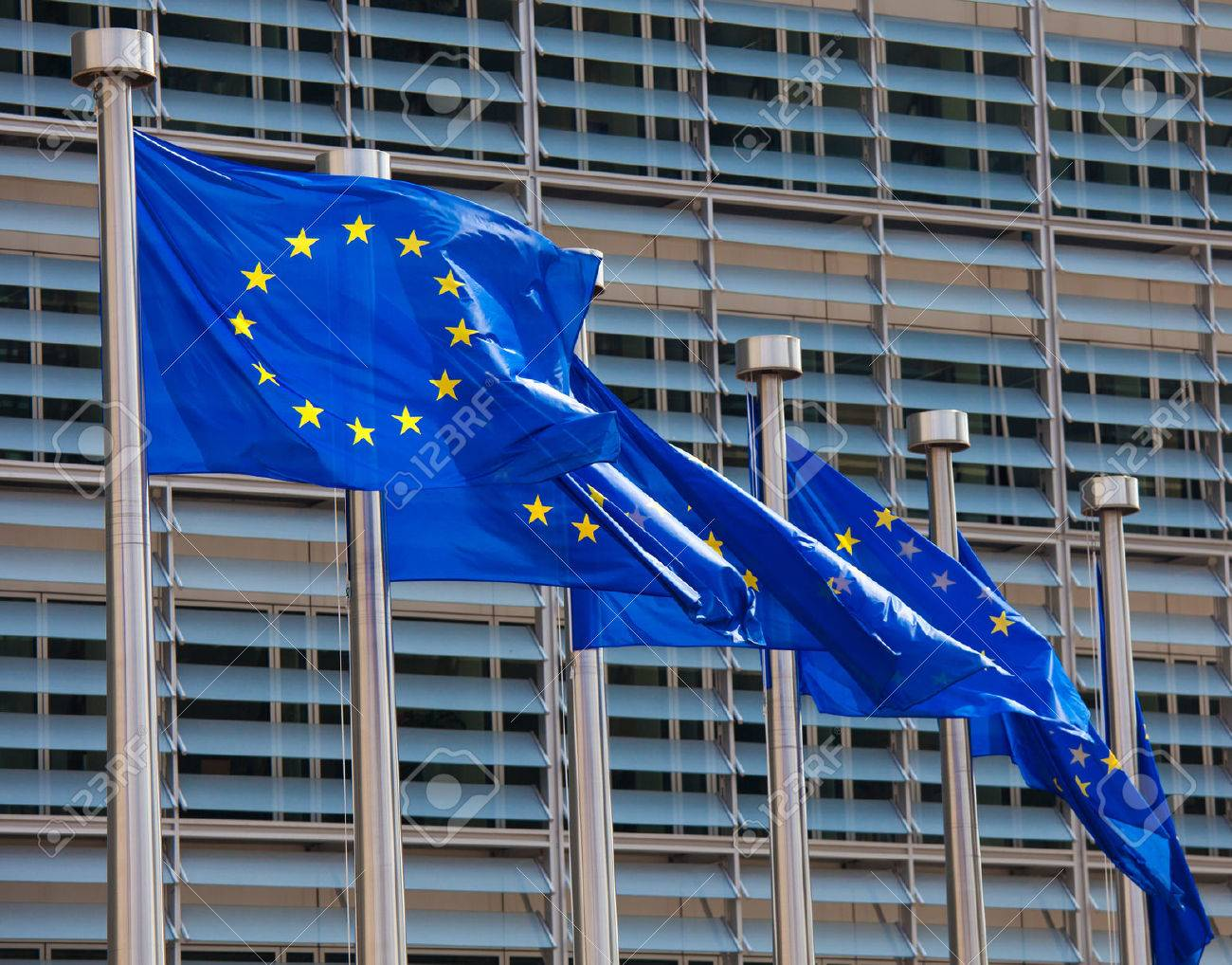 European flags in front of the Berlaymont building, headquarters of the European commission in Brussels. - 37205611