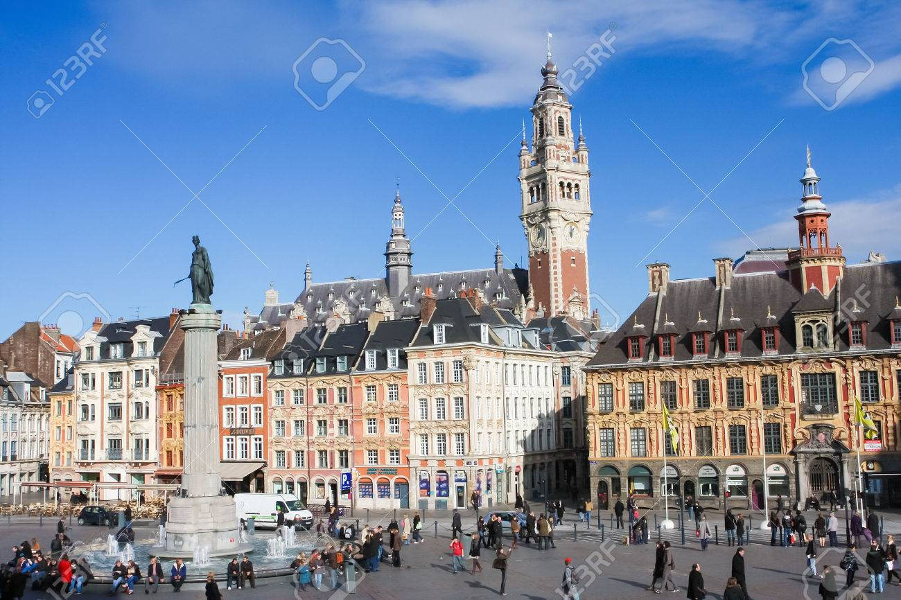 LILLE, FRANCE - NOVEMBER 2, 2009: Chambre of Commerce and Statue and Column of Deesse (1845) at the Place General de Gaulle in Lille, France. - 37855472