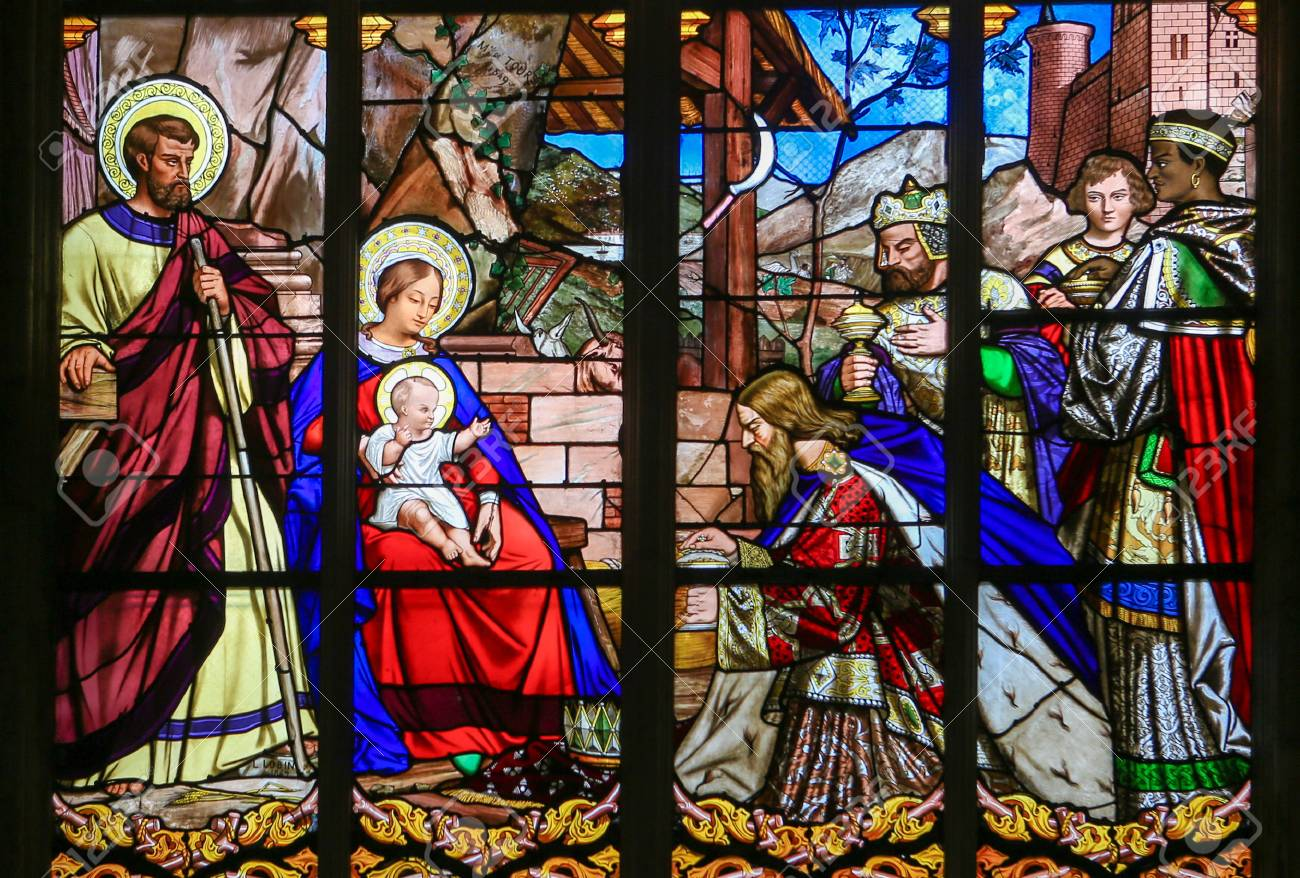 Stained glass window depicting the Epiphany, the Visit of the Three Kings in Bethlehem, in the Cathedral of Tours, France. - 47659814