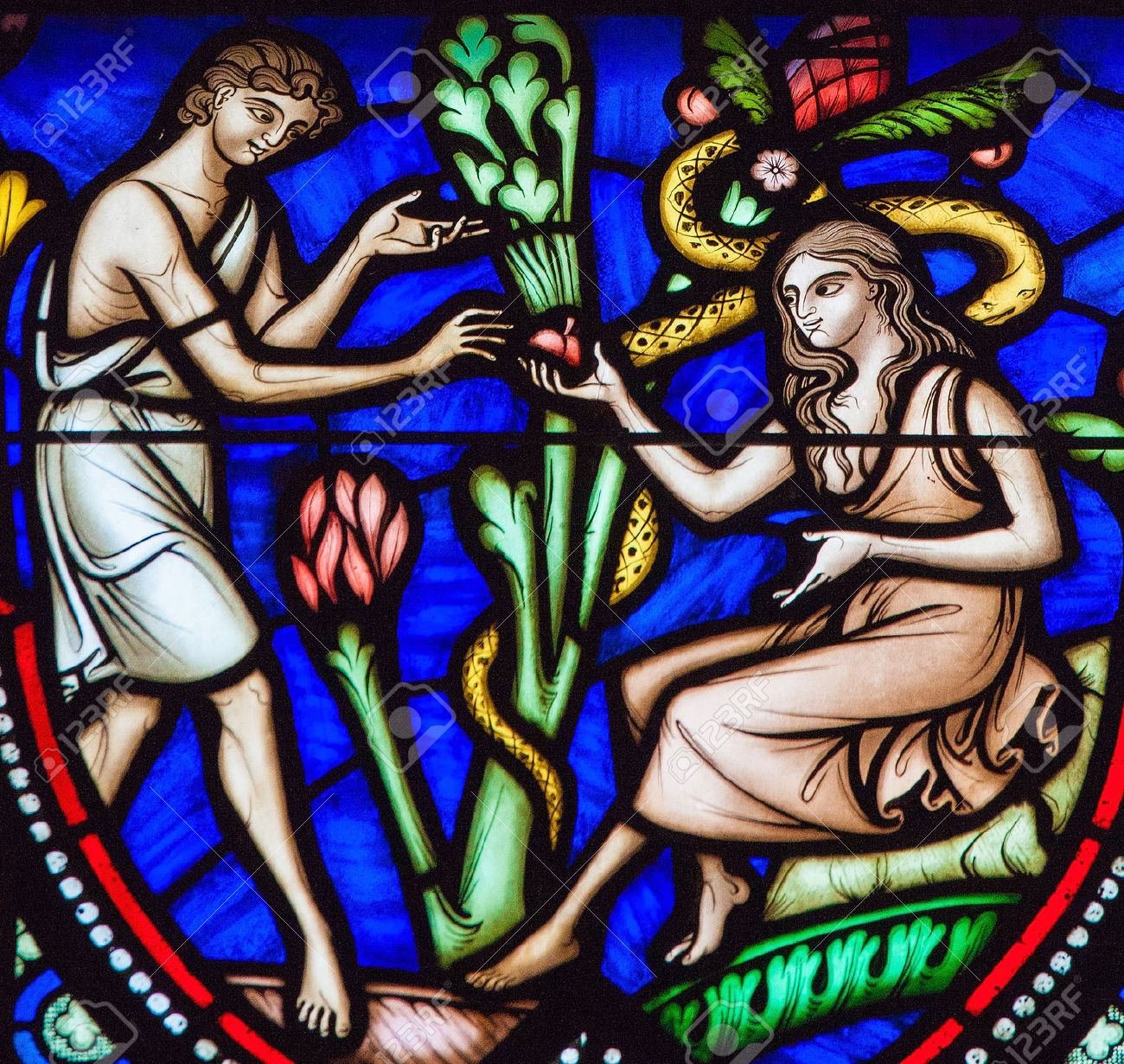 BRUSSELS, BELGIUM - JULY 26, 2012: Adam and Eve eating the Forbidden Fruit in the Garden of Eden on a stained glass window in the cathedral of Brussels. - 54680925