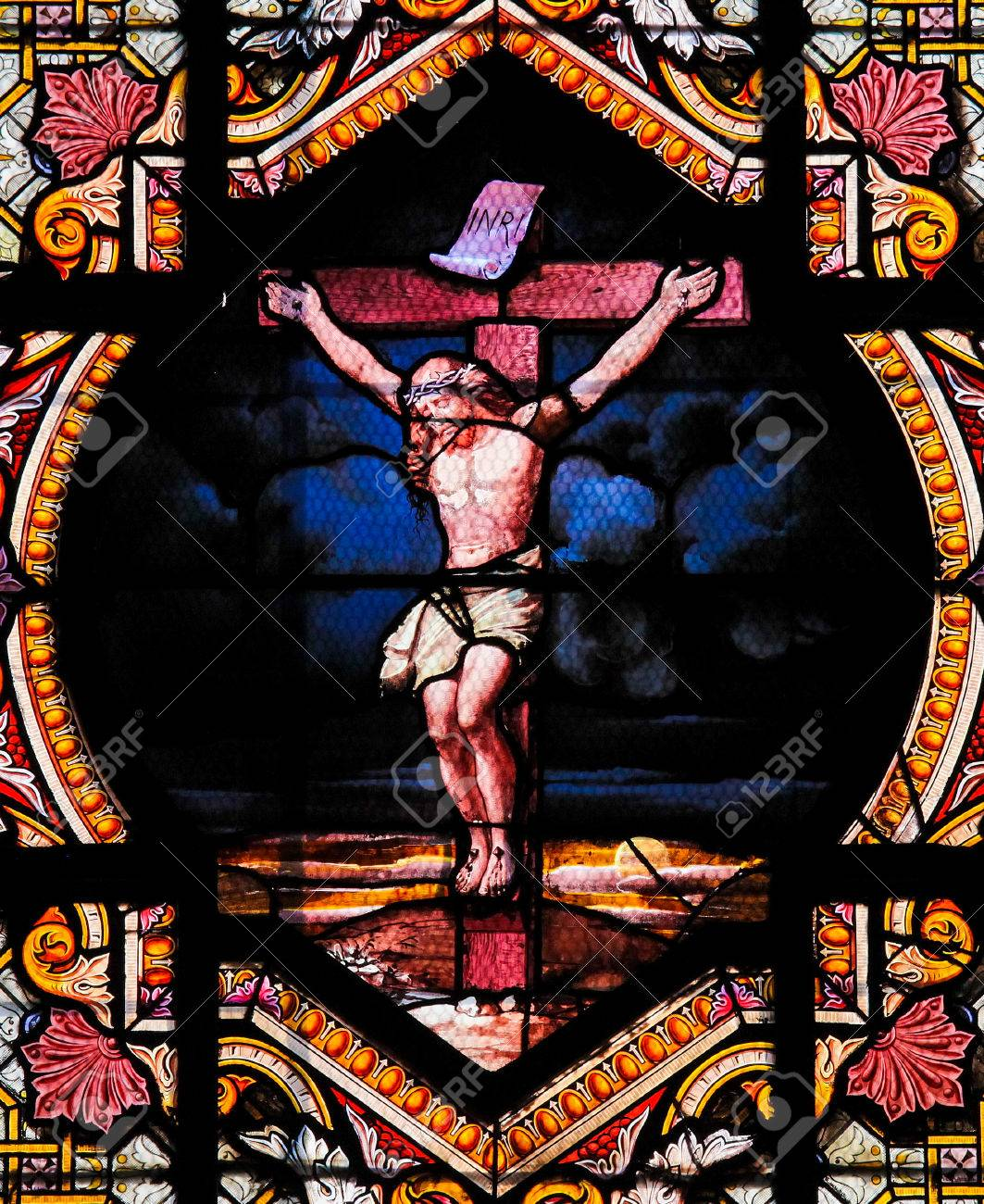 Stained Glass Window Depicting Jesus Christ On The Cross In Saint Sulpice Church Paris