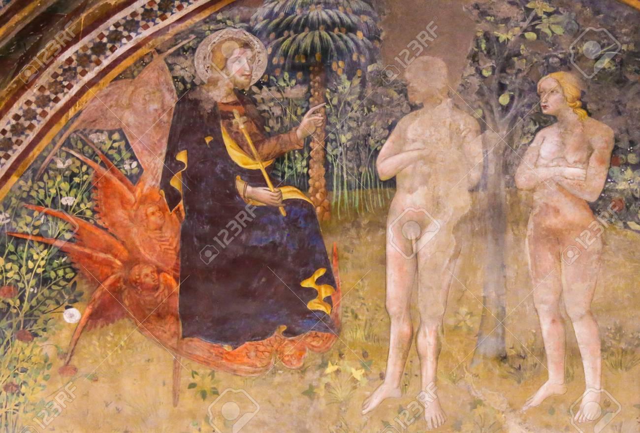 Renaissance Fresco (1365) by Bartolo di Fredi depicting Jesus, Adam and Eve in the Garden of Eden in the Collegiata of San Gimignano, Italy. - 87034043