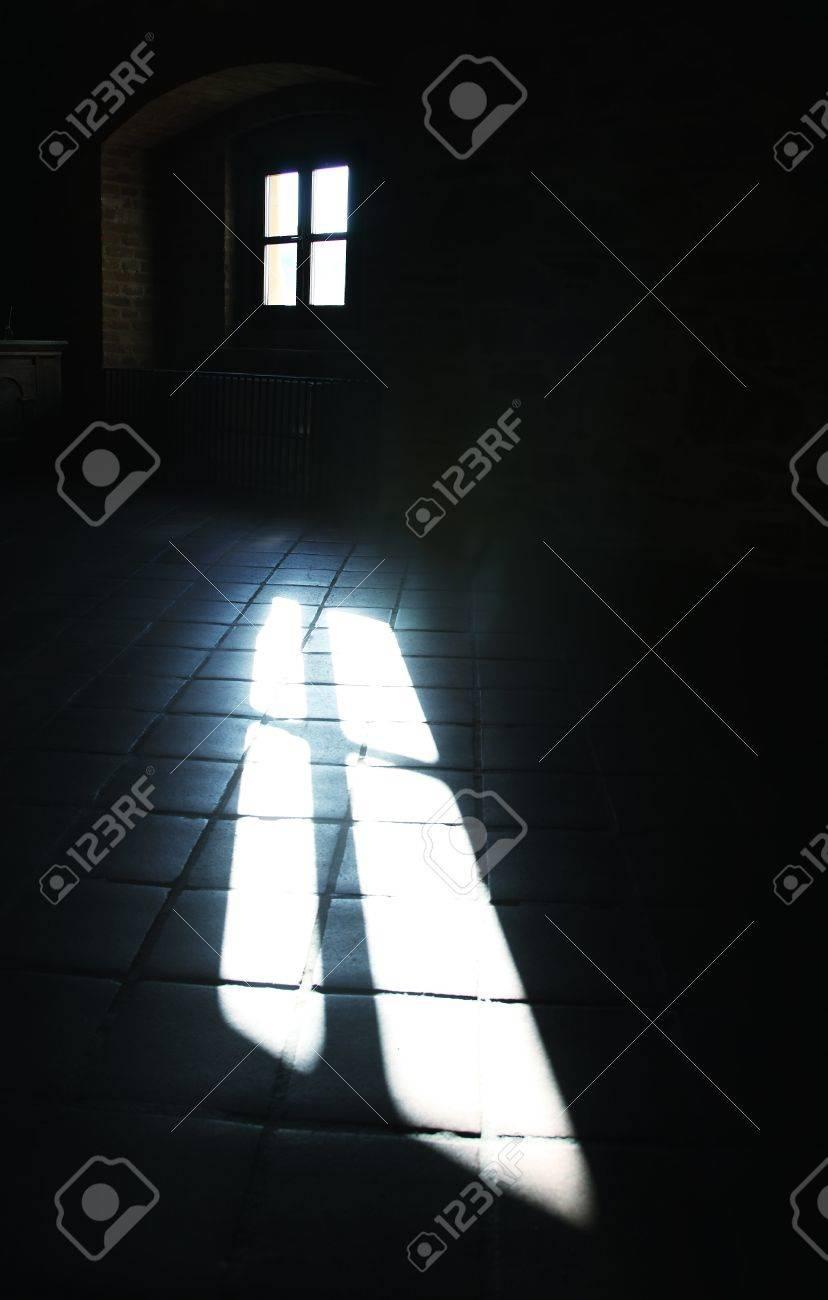 Dark room with light through window - Sunlight Through A Window In A Dark Room Stock Photo 16717958