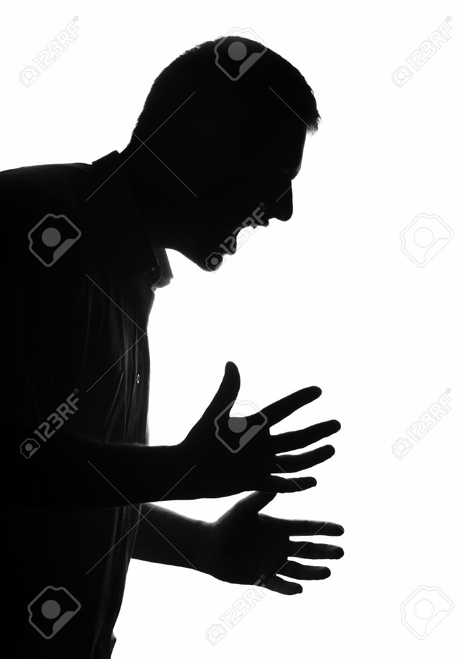 Man portrait silhouette profile screaming angry in studio isolated white background Stock Photo - 26016129