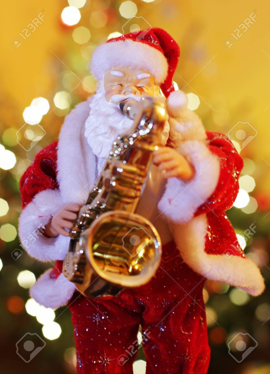 Musical christmas ornaments that play music - Santa Claus Figurine Playing Music On Saxophone Stock Photo 54395891