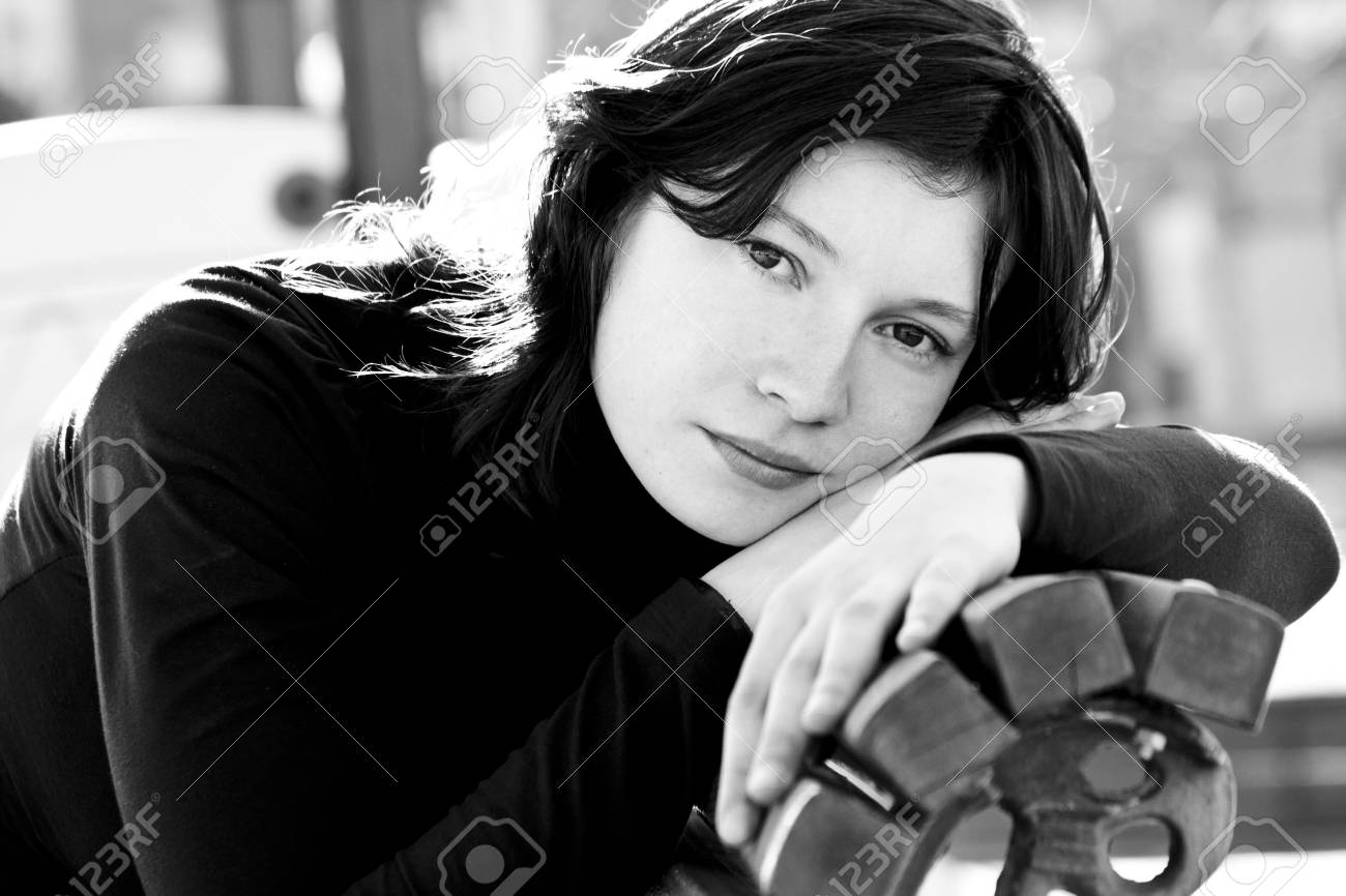 Black and white portrait of good looking woman in bench Stock Photo - 2546425