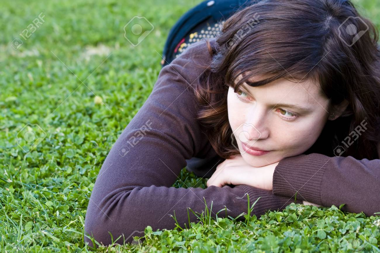 Cute green eyed woman on the grass Stock Photo - 2565031