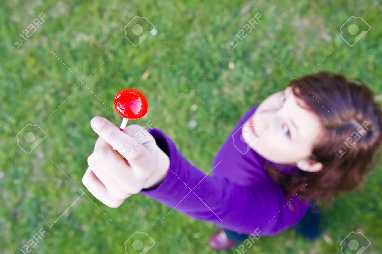 Young woman with red candy in hand Stock Photo - 3431688