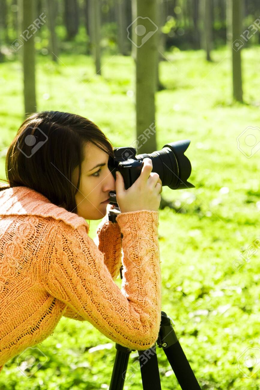 Young pretty female photographer in a forest. Stock Photo - 3860755