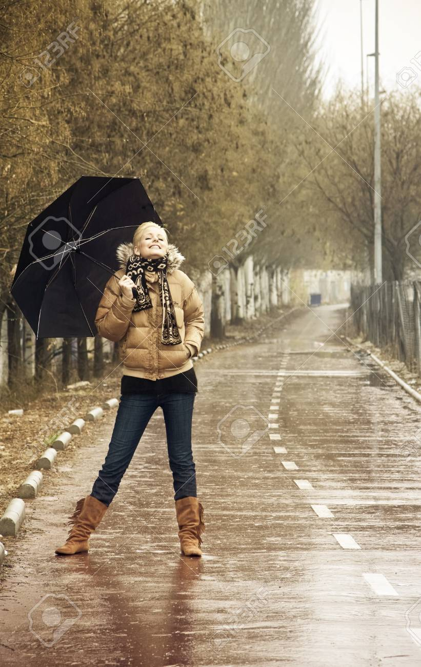 Happy young blond woman in a rainy day. Stock Photo - 4166206