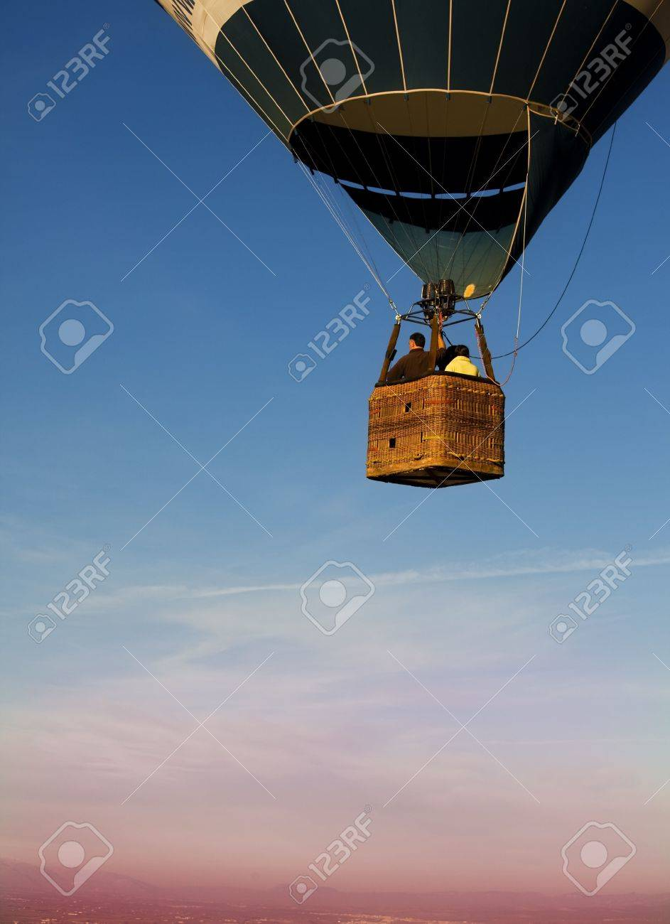 Unrecognizable people traveling in a multicolor balloon Stock Photo - 4625190